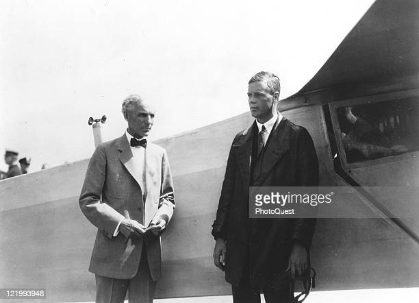 "The Lone Eagle, Charles A. Lindbergh, stands with Henry Ford beside the ""Spirit of St. Louis,"" the plane in which Colonel Lindbergh flew the first..."