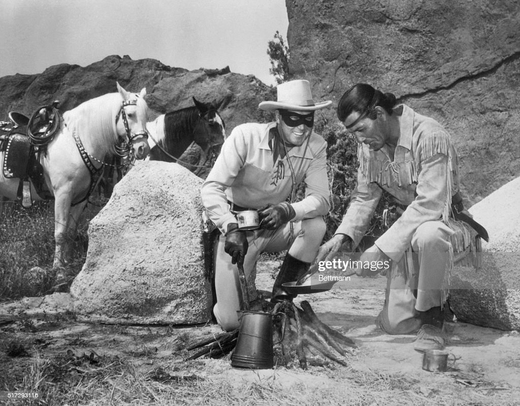 Lone Ranger and Tonto Characters Cooking Food over Camp Fire : News Photo