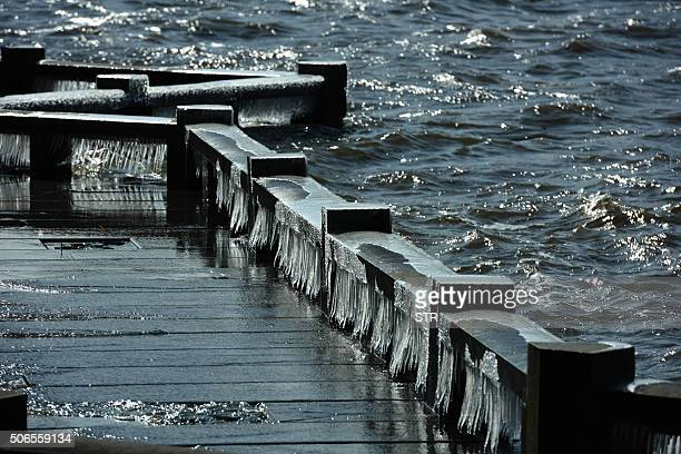 The long bridge at West Lake is covered with ice amid the cold in Hangzhou in eastern China's Zhejiang province on January 24 2016 Much of China...
