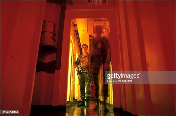 The long haul for the aircraft carrier the Charles de Gaulle In France On November 04 2000 The Marines make night rounds along the gangways of the...