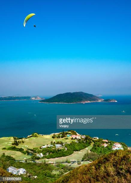 the long ji (dragon's back), flying over shek o in hong kong - vsojoy stock pictures, royalty-free photos & images