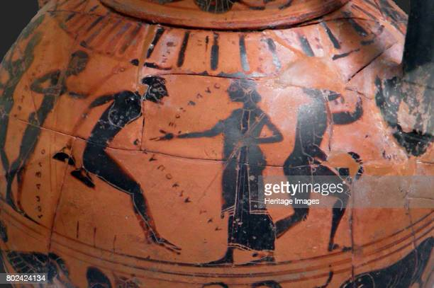 The long jump event at the ancient Olympic Games Attic blackfigured cup 540 BC Found in the collection of British Museum