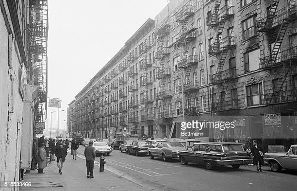 The Long Road Up. East Harlem, N.Y.: This is a view of East 100th Street in New York's East Harlem-one slum that is making its own fight for the...