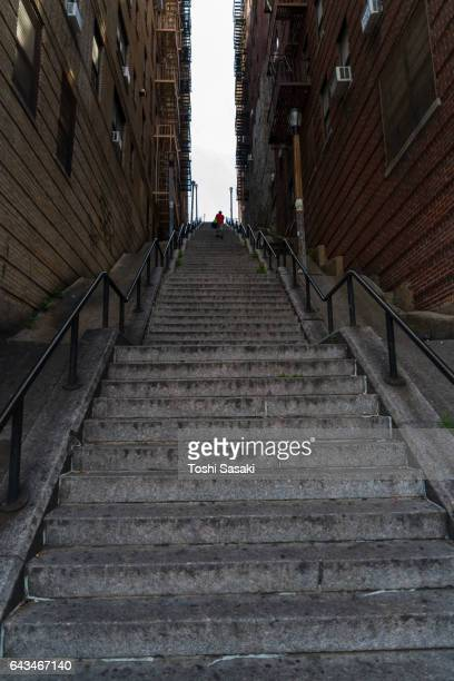 the long stairway goes through among the buildings at the bronx new york. - bronx stock pictures, royalty-free photos & images