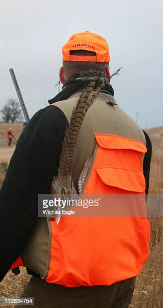 The long tail feathers of a rooster pheasant rising from a game vest shows a hunter's success during a recent Stephen F Austin State University...