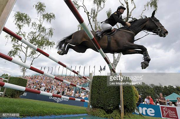 The Longines King George V Gold Cup Competitor at the water jump fence The event was won by tim Stockdale GBR riding First Direct Kalico Bay