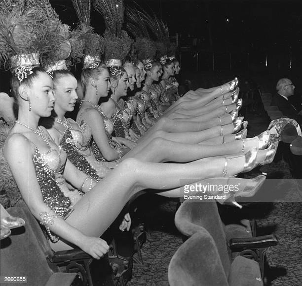 The longlegged Bluebell Girls stars of the Royal Variety Performance at London's Palladium Theatre relax in the stalls during rehearsals London...