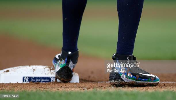 The Looney Tunes themed Nike shoes of Didi Gregorius of the New York Yankees in action during a game against the Seattle Mariners at Yankee Stadium...