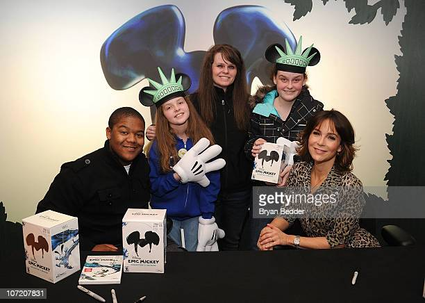 The Lopez family of Seattle Washington receive the first copy of Disney Epic Mickey for Wii game with Kyle Massey and Jennifer Grey at Disney Epic...