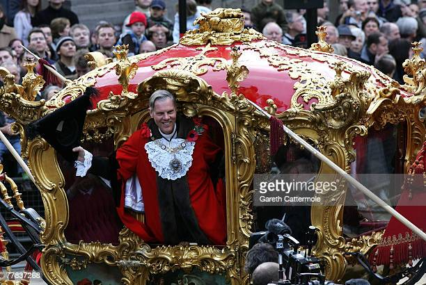 The Lord Mayor David Lewis waves from his coach during The Lord Mayor's Show on November 10 2007 in London The traditional yearly procession is 3...