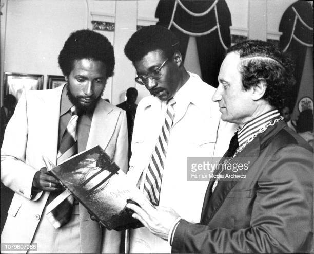 The Lord Mayor discussing the book This Is Sydney which was presented to each member of the team with Clive Lloyd the captain of the team and Andy...
