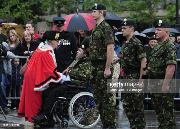 The Lord Mayor of Leeds talks to former Rifleman Martin Edwards who was injured while serving in Iraq in 2006 as The Rifles whose soldiers have seen...