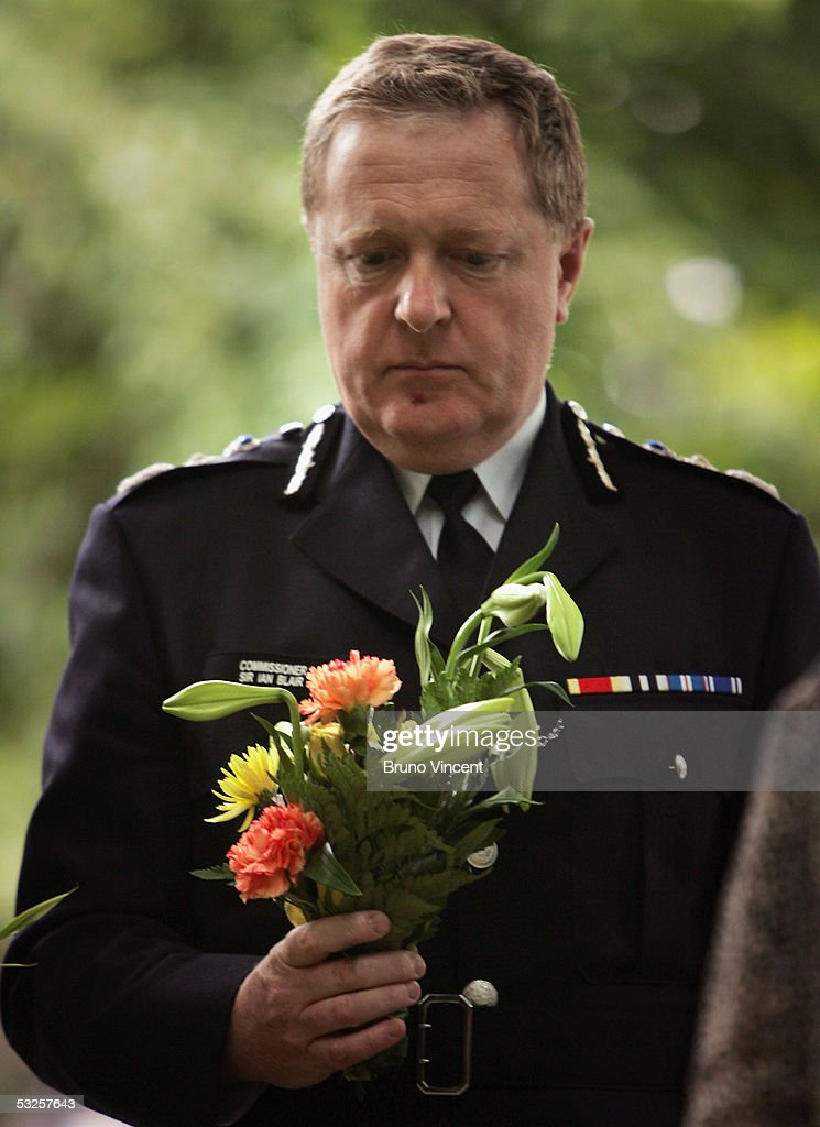 The Lord Mayor of London, Alderman Michael Savory, lays a bouquet of flowers in Victoria Embankment Gardens during a memorial service to remember those that were killed or injured in the London transport terror attacks July 19, 2005 in London. On July 7, 2005 four seperate explosions on the London transport network left at least 54 people dead and around 700 injured.