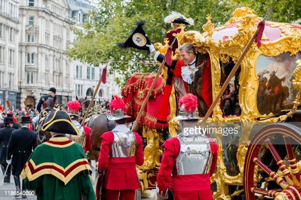 The Lord Mayor of London William Russell the 692nd Lord Mayor of the City of London waves as he rides in The Lord Mayor of London's State Coach drawn...
