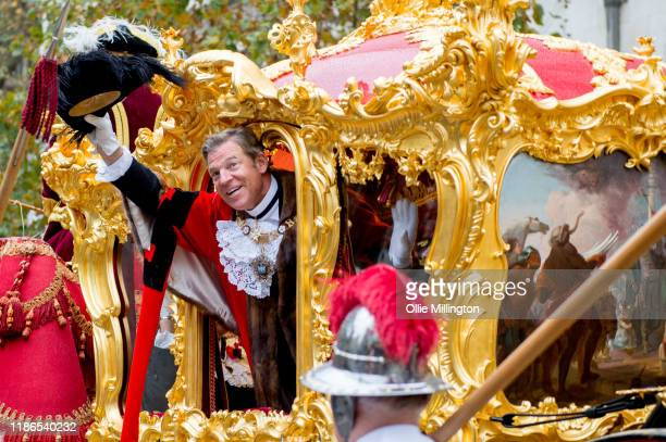 The Lord Mayor of London's State Coach drawn by six shire horses with Lord Mayor William Russell onboard leaves the Royal Courts of Justice during...