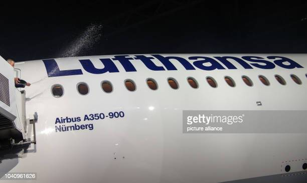 The Lord Mayor of Nuremberg Ulrich Maly christens the new Lufthansa Airbus A350900 aircraft with a bottle of sekt in Munich Germany 02 February 2017...