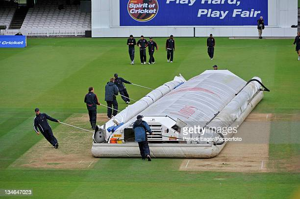 The Lord's groundstaff manoeuvre the Hovercover into position during one of the breaks for rain Pakistan v Australia 1st Test Lord's July 2010