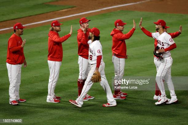 The Los Angeles Angels high-five on the pitcher's mound following a game against the Kansas City Royals at Angel Stadium of Anaheim on June 08, 2021...