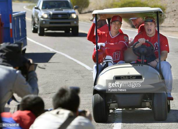 The Los Angeles Angels' Mike Trout drives a cart beside rookie Shohei Ohtani after the club's spring training in Tempe Arizona on Feb 20 2018 ==Kyodo