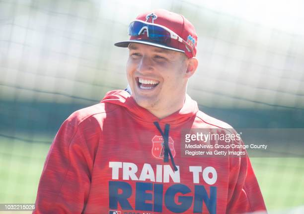 The Los Angeles Angels' Mike Trout laughs during the Halos' first fullsquad spring training baseball practice in Tempe Ariz Wednesday Feb 24 2016