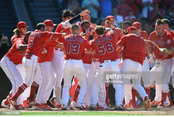 The Los Angeles Angels of Anaheim celebrate Matt Thaiss walkoff home run in the ninth inning to defeat the Baltimore Orioles 54 at Angel Stadium of...