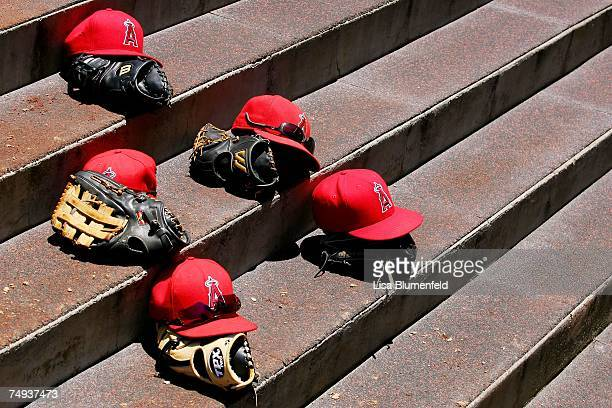 The Los Angeles Angels of Anaheim leave their caps and gloves on the steps of the dugout during the game against the Kansas City Royals at Angels...