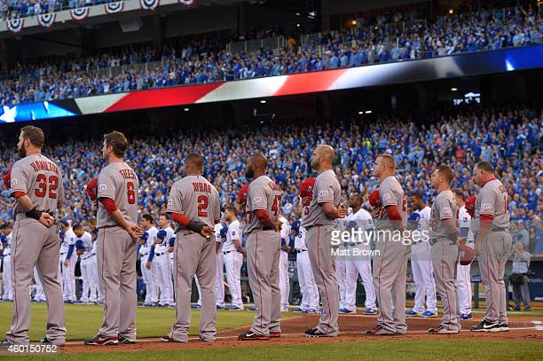 The Los Angeles Angels of Anaheim line up for the National Anthem before game 3 of the American League Division Series against the Kansas City Royals...