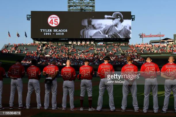 The Los Angeles Angels of Anaheim stand for a moment of silence before they play the Seattle Mariners at Angel Stadium of Anaheim on July 12 2019 in...