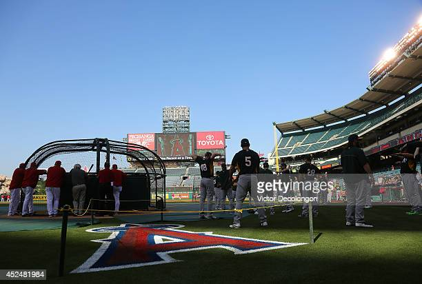 The Los Angeles Angels of Anaheim take batting practice as the Oakland Athletics start their stretch routine prior to their MLB game at Angel Stadium...