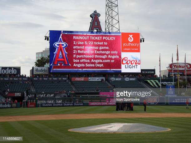 The Los Angeles Angels rainout policy is posted on the big screen after a game between the Minnesota Twins and the Angels scheduled for Wednesday May...