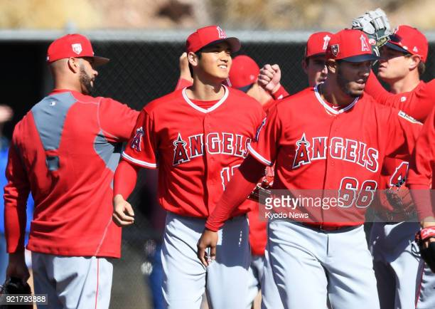 The Los Angeles Angels' Shohei Ohtani bumps fists with teammates during the club's spring training site in Tempe Arizona on Feb 20 2018 ==Kyodo