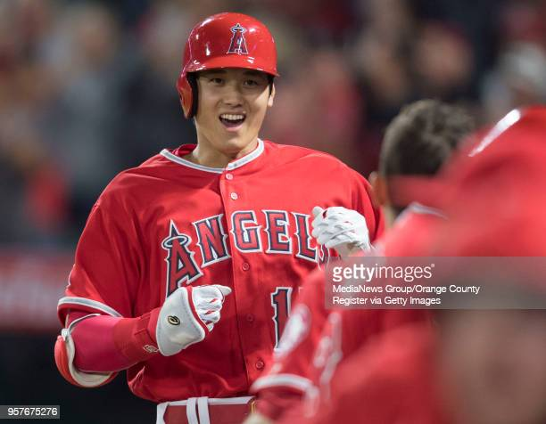 The Los Angeles Angels' Shohei Ohtani is greeted in the dugout after his seventh inning home run against the Minnesota Twins at Angel Stadium in...