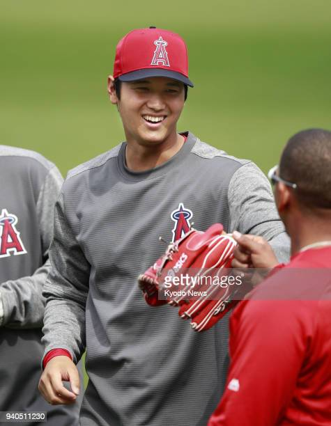 The Los Angeles Angels' Shohei Otani smiles at a teammate after playing catch at the Oakland Coliseum in Oakland California on March 31 2018 ==Kyodo