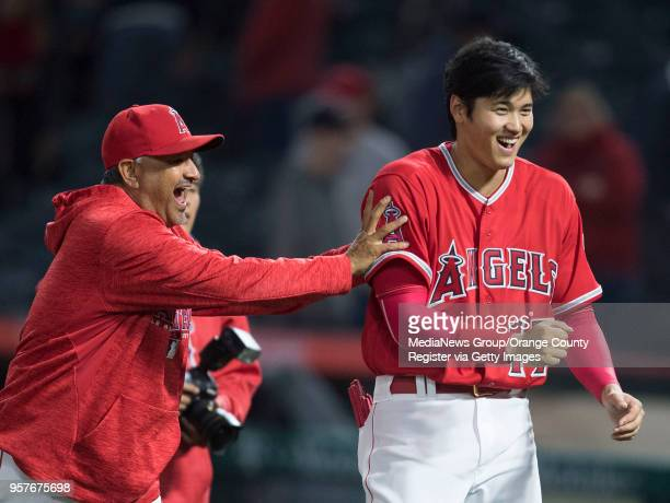 The Los Angeles Angels' Steve Soliz jokes around with Shohei Ohtani after the Angels' 74 victory over the Minnesota Twins at Angel Stadium in Anaheim...