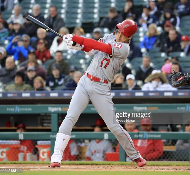 The Los Angeles Angels' two-way player Shohei Ohtani swings away in the first inning of a game against the Detroit Tigers on May 7 in Detroit. Ohtani...