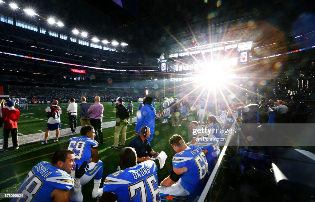 The Los Angeles Chargers offensive line sits on the bench as the Los Angeles Chargers take on the Dallas Cowboy at AT&T Stadium on November 23, 2017 in Arlington, Texas.
