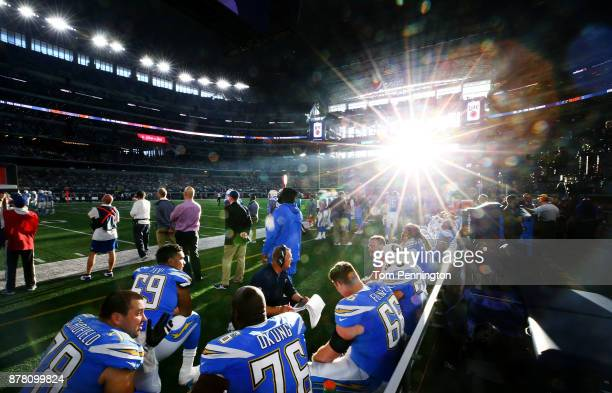 The Los Angeles Chargers offensive line sits on the bench as the Los Angeles Chargers take on the Dallas Cowboy at ATT Stadium on November 23 2017 in...