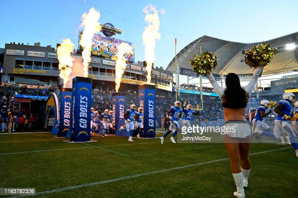 The Los Angeles Chargers run out onto the field to play the Seattle Seahawks for a preseason NFL football game at Dignity Health Sports Park on...
