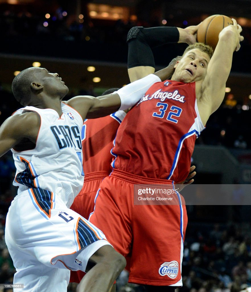 The Los Angeles Clippers' Blake Griffin (32) grabs a rebound over the Charlotte Bobcats' Bismack Biyombo in the first half at Time Warner Cable Arena in Charlotte, North Carolina, on Wednesday, December 12, 2012. The Clippers won, 100-94.