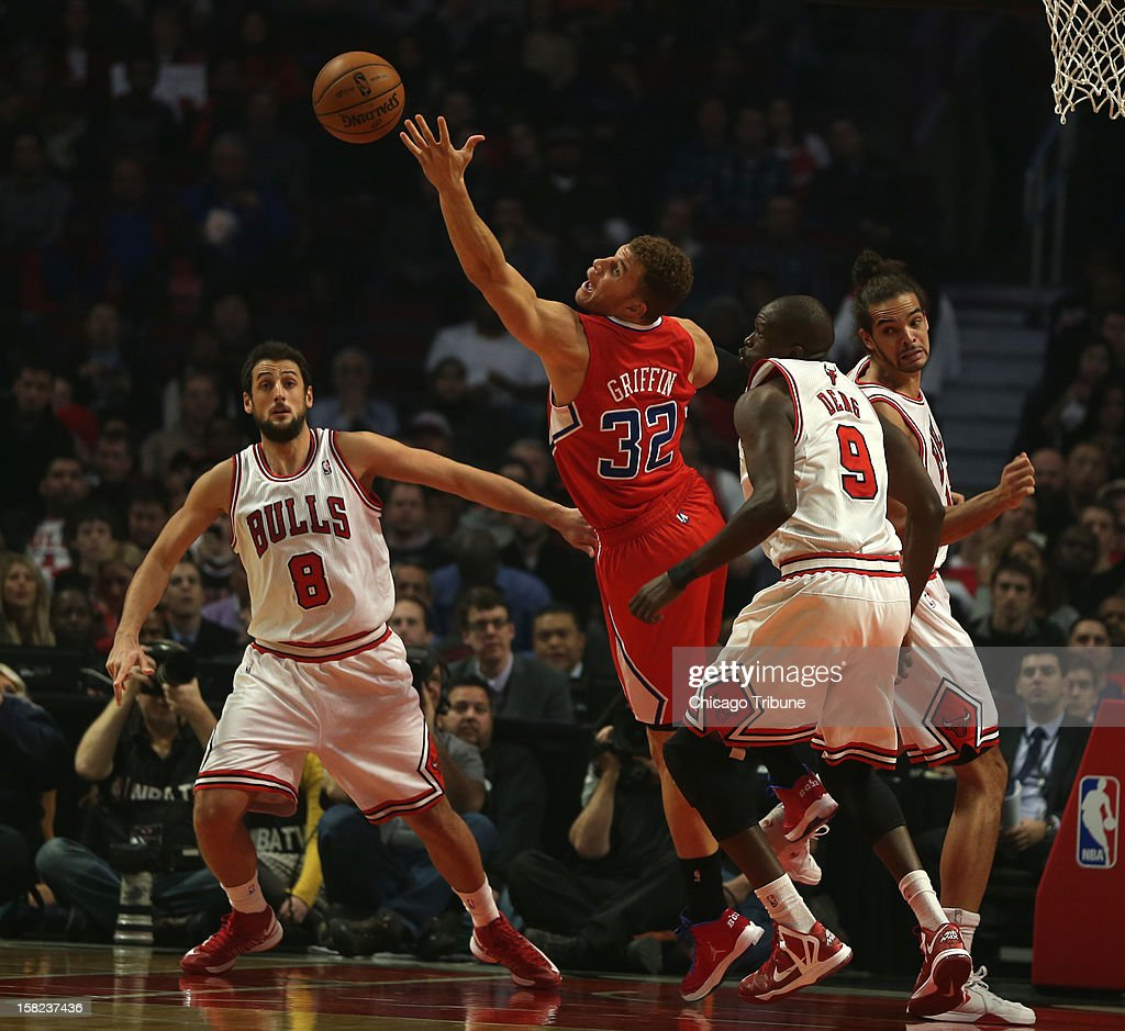 The Los Angeles Clippers' Blake Griffin, middle, reaches for rebound as the Chicago Bulls' Marco Belinelli, left, and Luol Deng watch in the first quarter at United Center in Chicago, Illinois, on Tuesday, December 11, 2012.