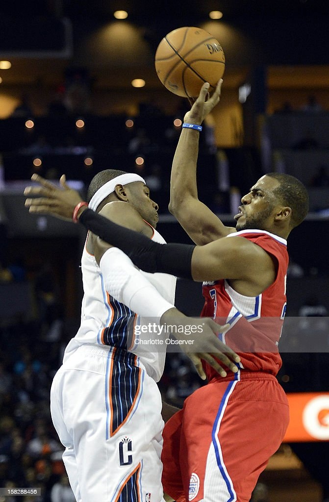 The Los Angeles Clippers' Chris Paul, right, shoots as he is fouled by the Charlotte Bobcats' Brendan Haywood in the second half at Time Warner Cable Arena in Charlotte, North Carolina, on Wednesday, December 12, 2012. The Clippers won, 100-94.