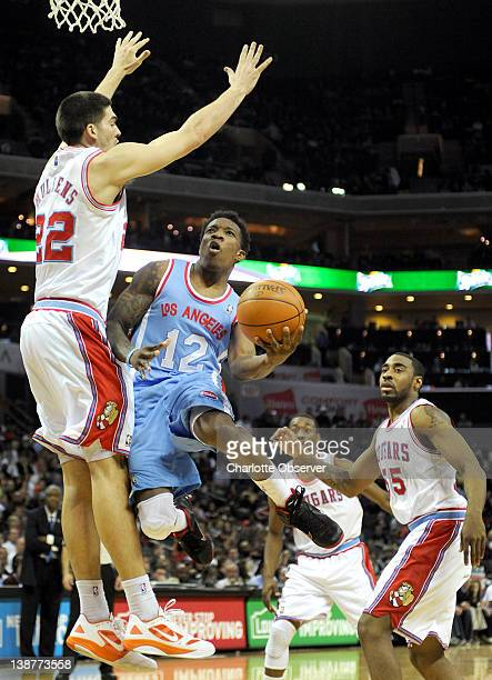 The Los Angeles Clippers' Eric Bledsoe drives around the Charlotte Bobcats' Byron Mullens, left, for a shot during second-half action at Time Warner...
