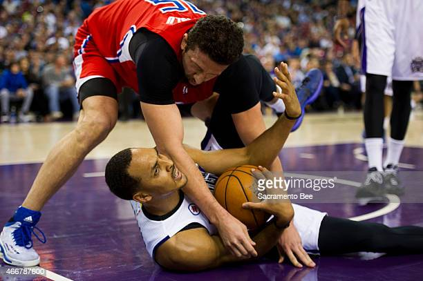 The Los Angeles Clippers' Hedo Turkoglu falls onto the Sacramento Kings' Ryan Hollins during the first quarter on Wednesday, March 18 at Sleep Train...