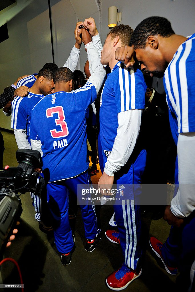 The Los Angeles Clippers huddle up in a hallway before facing the Los Angeles Lakers at Staples Center on January 4, 2013 in Los Angeles, California.
