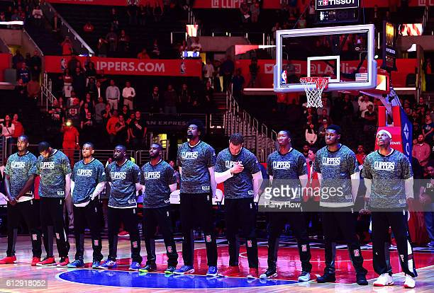 The Los Angeles Clippers line up for the National Anthem before a preseason game against the Toronto Raptors at Staples Center on October 5 2016 in...