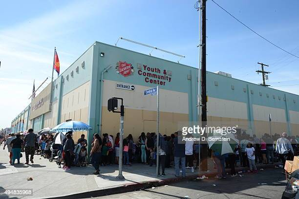 The Los Angeles Clippers participate in Feed The Community event at the Salvation Army Siemon Family Youth and Community Center in Los Angeles...