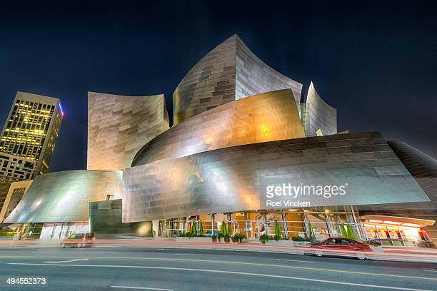 The Los Angeles Concert Hall in Downtown Los Angeles at night. The building is lighted. It is the fourth hall of Music Center and was designed by...