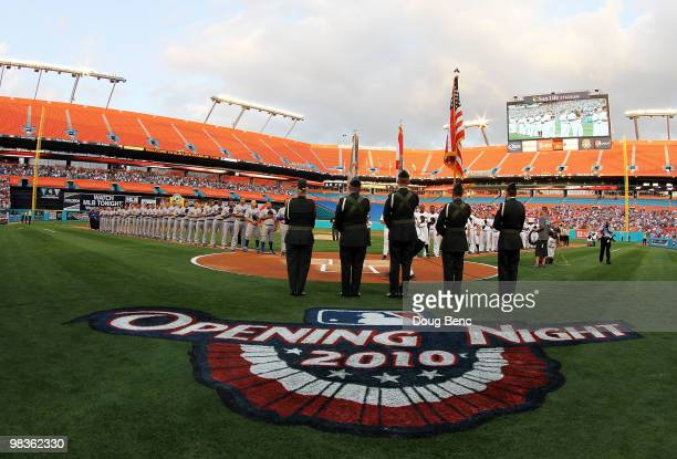 The Los Angeles Dodgers and the Florida Marlins line up for the National Anthem before the Marlins home opening game at Sun Life Stadium on April 9...