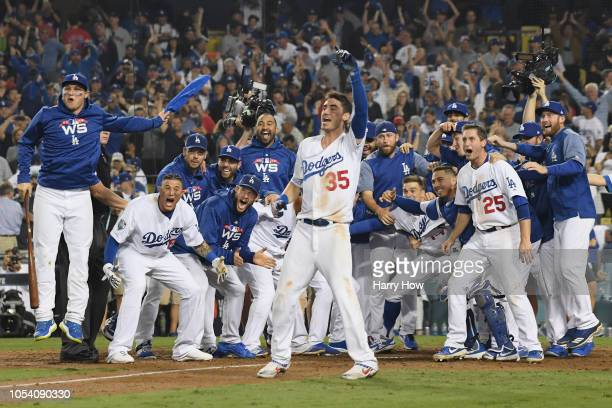 The Los Angeles Dodgers await to congratulate Max Muncy at home plate after his eighteenth inning walkoff home run to defeat the the Boston Red Sox...