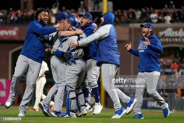 The Los Angeles Dodgers celebrate after beating the San Francisco Giants 2-1 in game 5 of the National League Division Series at Oracle Park on...